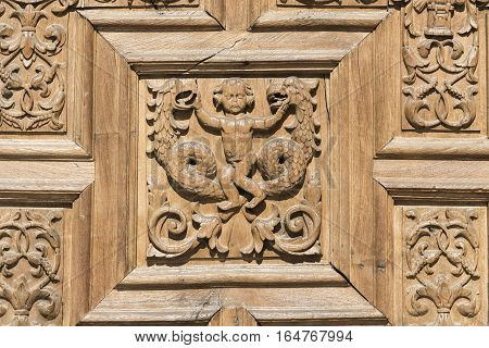 Leon (Castilla y Leon Spain): exterior of the medieval cathedral in gothic style: facade a wooden door