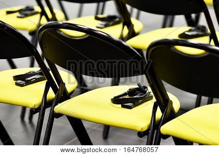 Translation headphones on a chair in a conference room
