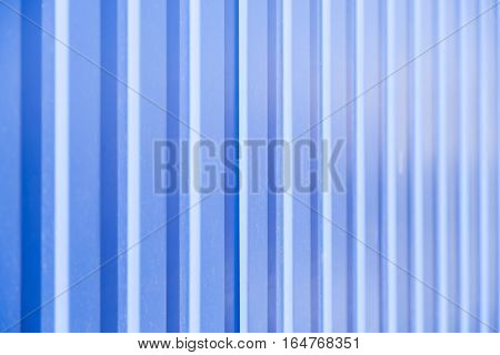 Corrugated Fence Of Yellow Metal Sheets With Screw