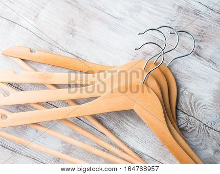 Wooden clothes hangers on bright background. What nothing to wear concept
