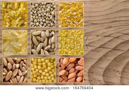 Collage consisting of different grains such as bulgur quinoa polenta rice couscous millet. Food background. Healthy lifestyle concept. Closeup macro shot.