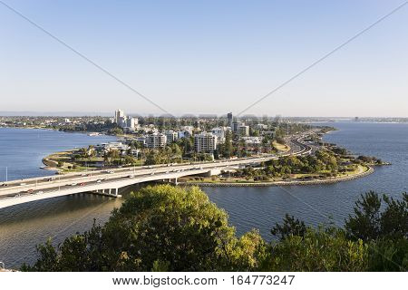 The South Perth skyline and the Narrows Bridge as seen from Kings Park across the Swan River, Western Australia, Australia.