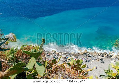 The beach with stone pebbles in the village of Vernazza. Cinque Terre National Park, Liguria, Italy.