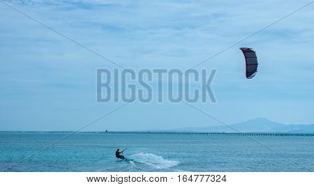man kite surfing on Red sea in Winter bad weather