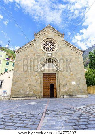 Manarola town Riomaggiore La Spezia province Liguria northern Italy. View of the San Lorenzo church facade monument landmark. Part of the Cinque Terre National Park and a UNESCO World Heritage Site.