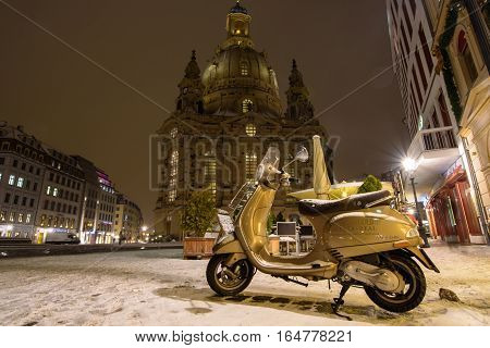 moped under the snow in Dresden in January 2016