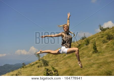 Beautiful high jump. Woman jump in expressive dance pose. she was jumping on trampoline