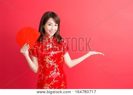 beauty woman show something and take red envelopes in chinese new year