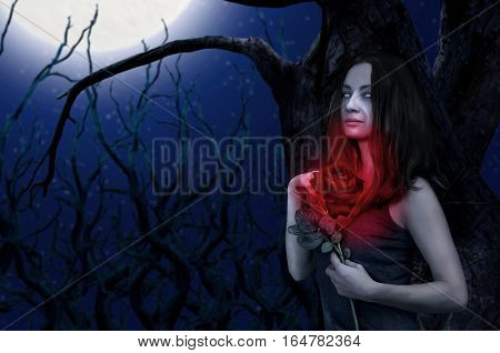Blind zombie girl holding rose on dead forest background. Halloween concept. Gothic concept. Horror concept.