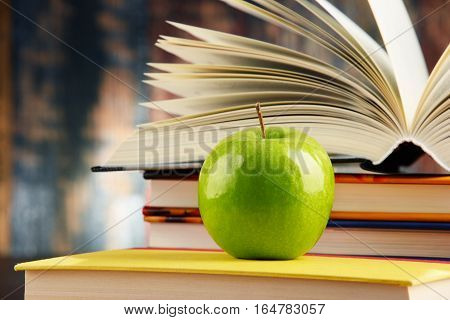 Composition With Hardcover Books And Apple