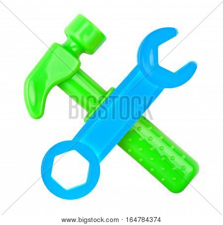 plastic hammer and wrench isolated on white