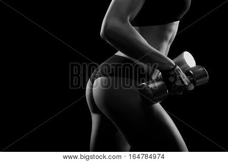 No stepping back. Horizontal monochrome closeup of sexy toned buttocks of a female fitness model copyspace