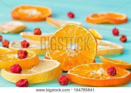 Sliced citrus fruits and rowan berry close up