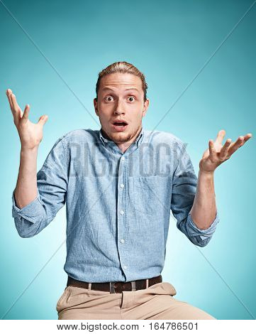 The Surprised Young Man Over Blue Background