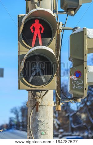 The traffic light on the street in the prohibitory sign which lights up