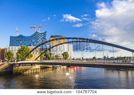 City of Warehouses district (Speicherstadt) in Hamburg. Building of Elbphilharmonie (Elbe Philharmonic Hall) on background. Niederbaumbrucke Bridge on foreground