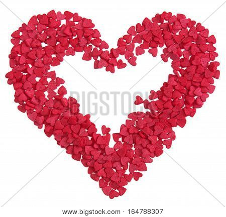Red heart shape made of small hearts candy sprinkles over white
