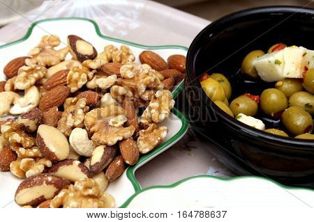 Olives, Feta Cheese, Crisps, Walnuts, Almonds, Cashew Nuts, Brazil Nuts And Hazelnuts Served With An
