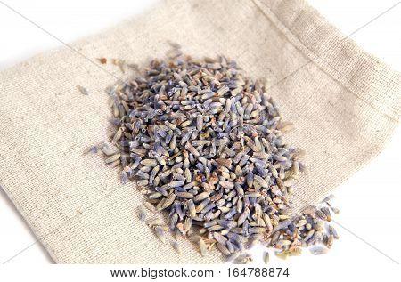dry lavender flowers on burlap bag over white background