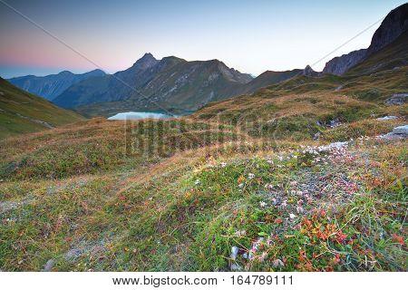 morning over alpine lake Allgauer Alps Germany