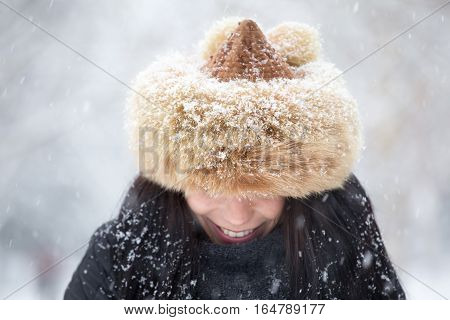 Brunette Woman Wearing Furry Hat