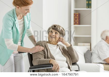 Woman Looking At Her Nurse