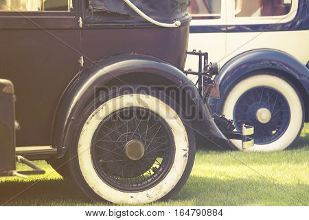 Vintage Car Wheels - Classic Vehicles in line