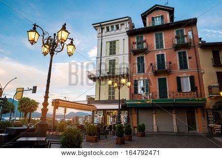 Classic town buildings and sky. Old street lights. Early morning in Stresa.