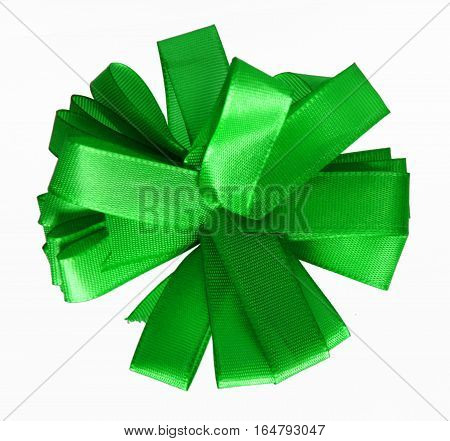 Green ribbon bow in the shape of cornflower isolated on white background