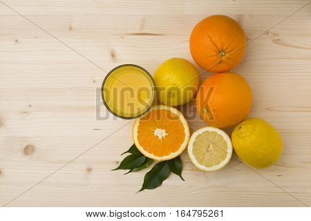 citrus fruits on the wooden table background