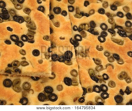 Focaccia Bread With A Lot Of Slices Of Olives From The Italian T