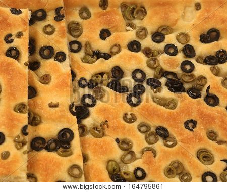 Focaccia Bread With A Lot Of Typical Olives From The Mediterrane