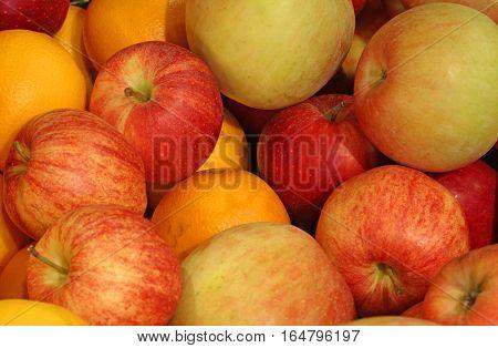 Background Of Ripe Apples And Oranges Orange