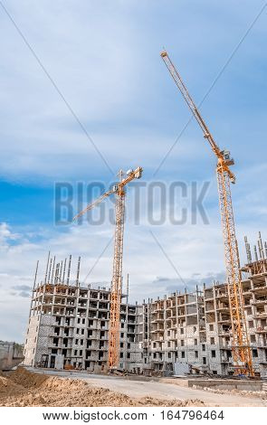 New skyscraper and construction cranes/New residential high-rise buildings and industrial cranes