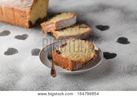 Sliced Cake And Heart Of Flour On Wooden Desk