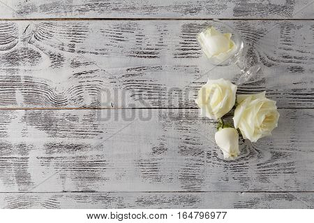 Valentine Background, White Rose Flowers And Petals Scattered On White Rustic Wood, Top View With Co