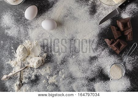 Baking Cake Ingredients. Bowl, Flour, Eggs, Eggbeater On Black Chalkboard From Above. Cooking Course