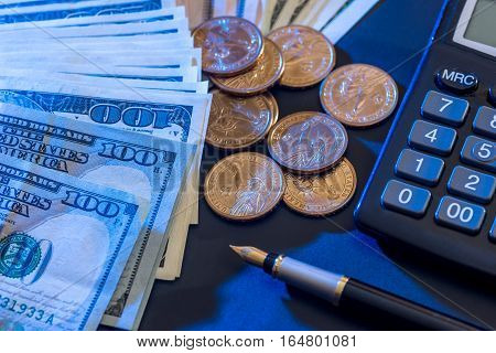 US dollars coin with calculator and pen.