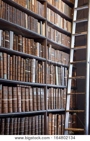 Old books on a shelf in a library
