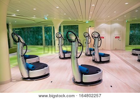 ROTTERDAM - NOV 24 2016: Power Plates in the fitness center on board of the AIDAprima cruise ship.