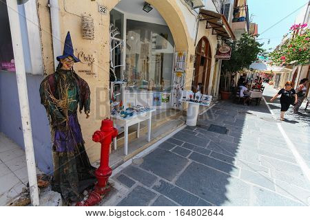 Rethymnon, Island Crete, Greece- July 1 2016: The scarecrow near the store on narrow street of Rethymnon (part of Old Town) where there are a lot of small cafes and shops