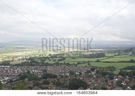 Village, town surrounded by countryside with mountainous background, British Village in the countryside