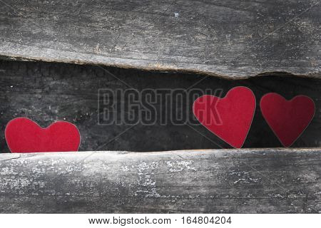 Old wooden background Red heart on the table