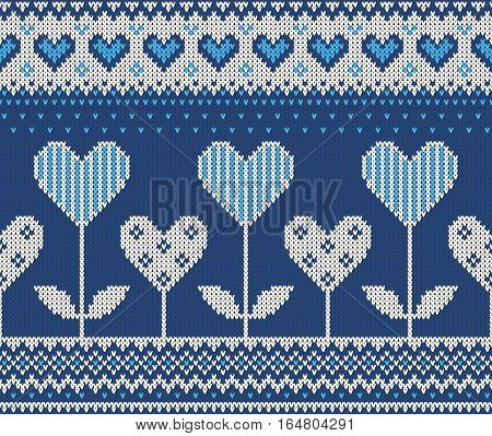 Seamless pattern on the theme of holiday Valentine's Day with an image of the Norwegian and fairisle patterns. Hearts-flowers on a blue background. Wool knitted texture. Vector Illustration