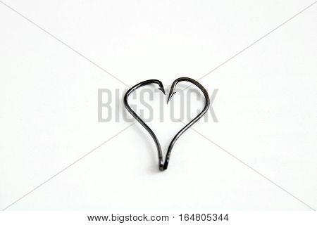 The Metal Hooks Placed Heart Symbols On White Background