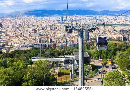 Barcelona, Spain - May 29, 2016: Montjuic funicular, panaramic view of Barcelona, skyscraper Tower Aguas de Barcelona