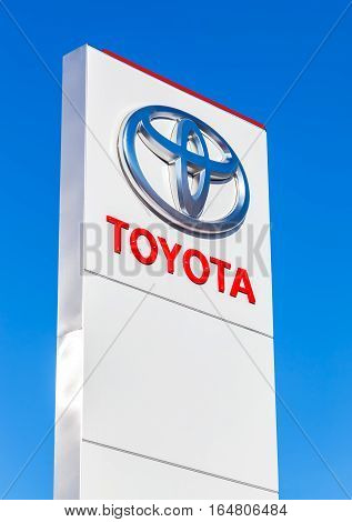 MOSCOW RUSSIA - JUNE 13 2016: Official dealership sign of Toyota against the blue sky background. Toyota Motor Corporation is a Japanese automotive manufacturer