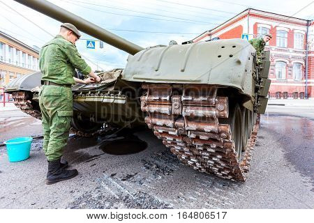 SAMARA RUSSIA - MAY 9 2016: Soldiers wash russian battle tank T-72