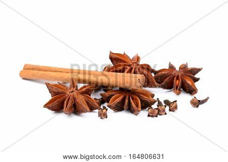 Aromatic star anise, cloves and cinnamon isolated on white background