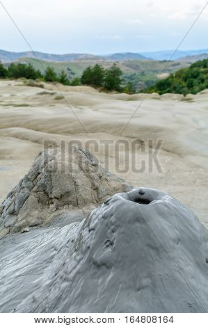 Vertical View With Muddy Volcano Closeup. Natural Park With Muddy Volcanoes, Dramatic Landscape, Uni